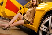 Beautiful woman with yellow sport car