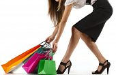 Beautiful stylish woman pulling shopping bags