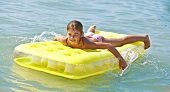 Young Brown Haired Child on Air Bed