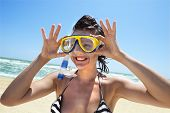 Happy diving girl in a swimming mask and snorkel