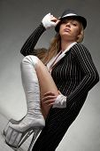 Attractive cabaret girl in tailcoat
