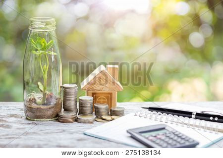 Savings Plan To Invest In Real Estate With Simulated Houses And Coins. Concept For Property Ladder,  poster