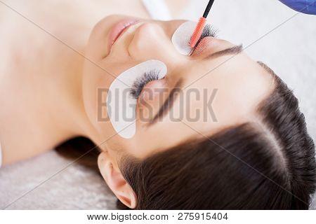poster of Eyelashes Extensions. Fake Eyelashes. Eyelash Extension Procedure. Professional Stylist Lengthening