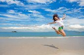 Girl Jumping Gracefully At The Beach