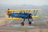 picture of orifice  - A vintage Stearman flies in formation over Phoenix - JPG