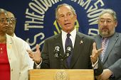 NEW YORK - AUGUST 15:  New York City Mayor Michael Bloomberg (C) speaks about heat related issues affecting New Yorkers at the Wakefield Senior Center on August 15, 2005 in Jamaica, New York City, NY