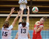 KAPOSVAR, HUNGARY - NOVEMBER 25: Zsanett Pinter (red 2) in action at the Hungarian Championship voll