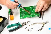 The Electronics Technician Replaces The Non-working Element Of The Electronic Device With A Solderin poster