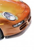 Head lamp of orange Porche car