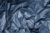 Plastic Texture Of Black Cellophane On A Crumpled Bag poster