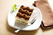 stock photo of marsala  - tiramisu dessert and fork on a plate - JPG