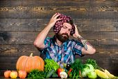 Fresh Organic Harvest. Farmer Bearded Guy With Homegrown Harvest Grapes Put On Head. Grapes From Own poster