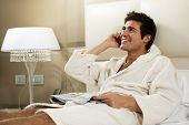 Relaxed Man in Bed, hotel or domestic room poster