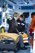 Female Paramedic Assisting Injured Woman