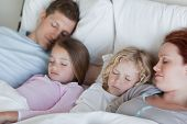 Young family snoozing together