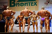 MOSCOW - APRIL 16: Three bodybuilders show their backs to the audience at Open Cup of bodybuilding a