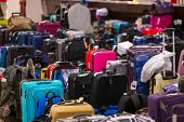 Large large amount of lost baggage at the airport. poster