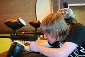 Teen Boy Aiming Paintball Gun