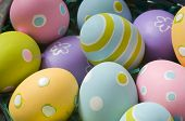 picture of easter-eggs  - Brightly colored Easter eggs in a basket - JPG