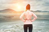 Running woman. Runner is jogging in winter day. Female fitness training outdoors poster