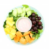 Fresh Fruit Tray And Yogurt Over White