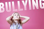 Bullying Concept. Stressed, Depressed, Unhappy Child Girl Holding Hands On Her Head Over Pink Backgr poster