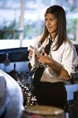 Bartender cleaning a wine glass