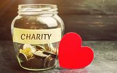 Glass Jar With The Words Charity And The Heart. The Concept Of Accumulating Money For Donations. Sav poster