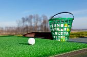 Golf ball and bucket