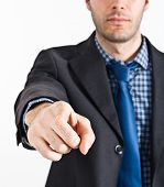 Portrait of a businessman pointing his finger at you