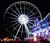 LONDON- DEC 17: Crowds of 1000s enjoy the rides and attractions of the famous Winter wonderland, hel