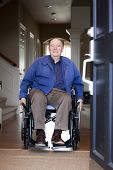 picture of entryway  - Elderly 90 yr old man in wheelchair at his front door - JPG