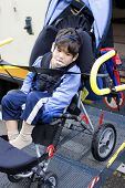 image of physically handicapped  - Disabled little boy on school bus wheelchair lift - JPG