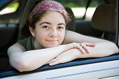 Teen In Car Window