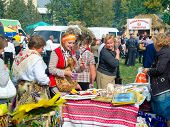 SUMY, UKRAINE - SEPTEMBER 22: Unidentified people people choose gifts at annual agro exhibition SUMY-2012 on September 22, 2012 in Sumy, Ukraine