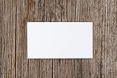 image of shaky  - Empty white card over old textured wooden background - JPG