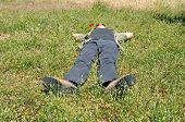 Man Lying On Grass