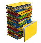a pile of multi-colored folders with documents