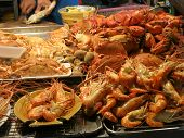 foto of crap  - view of tasty sea food shrimps and craps in a local beach restaurant in Thailand - JPG