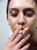 Close-up Of Woman With Cigarette