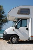 stock photo of campervan  - The front section of a low profile coach built motorhome - JPG