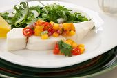 stock photo of halibut  - Poached halibut with peach salsa and green salad - JPG