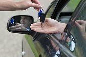 Man Receiving Car Key.