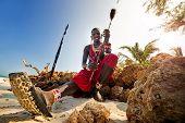 Maasai by the ocean on the beach
