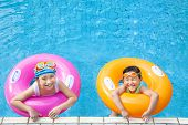 Happy Children Having Fun  In The Swimming Pool