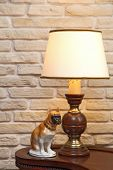 Figurine Of A Dog About A Lamp