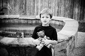 Little boy holding his stuffed animal.