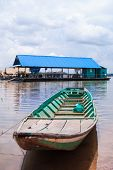 foto of pontoon boat  - green boat and raft are floating on river - JPG