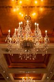 stock photo of flambeau  - Beautiful huge grass chandelier in grand ballroom - JPG
