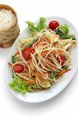 som tam thai, green papaya salad, sticky rice in bamboo container